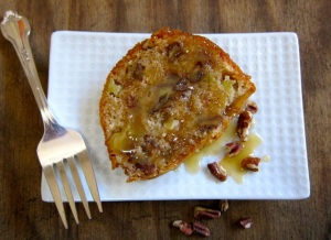 A homemade pound cake filled with apples, studded with pecans and covered with a caramel glaze.